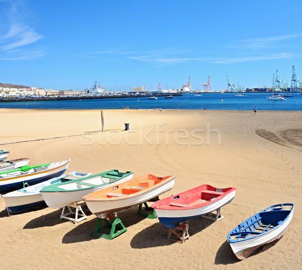 Beach with old boats and big port at Las Palmas, Gran Canaria. Stock photo © hamik