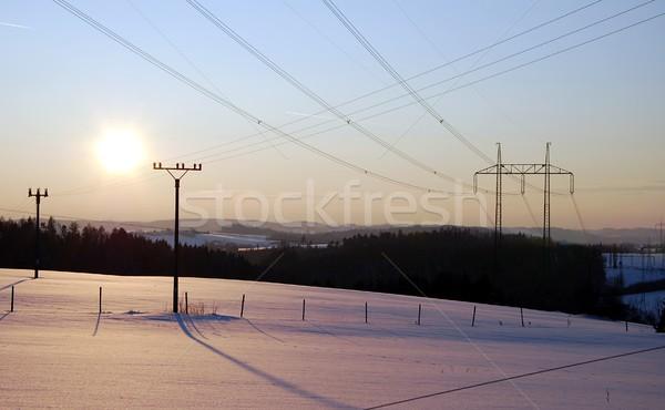 Inverno pôr do sol paisagem poder linha árvore Foto stock © hamik