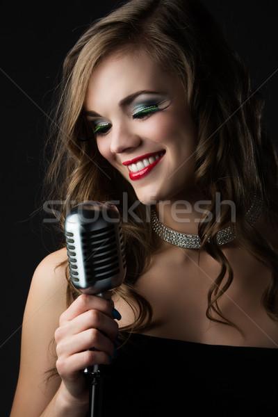 Beautiful female singer Stock photo © handmademedia