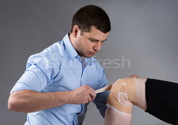 Adult male physiotherapist Stock photo © handmademedia