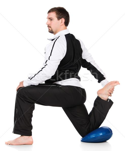 Felnőtt férfi atléta visel feketefehér tréningruha Stock fotó © handmademedia