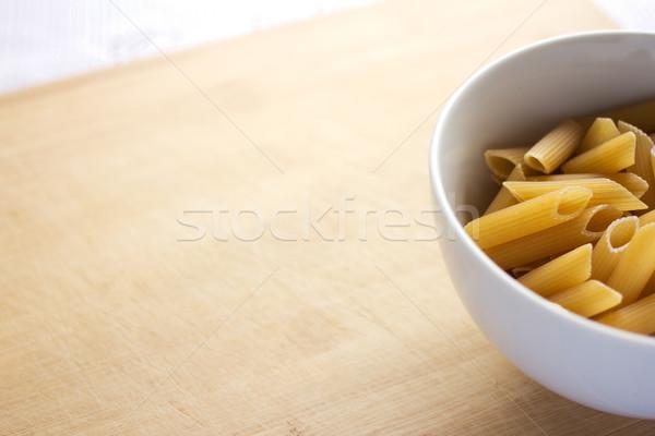 Uncooked penne pasta Stock photo © handmademedia
