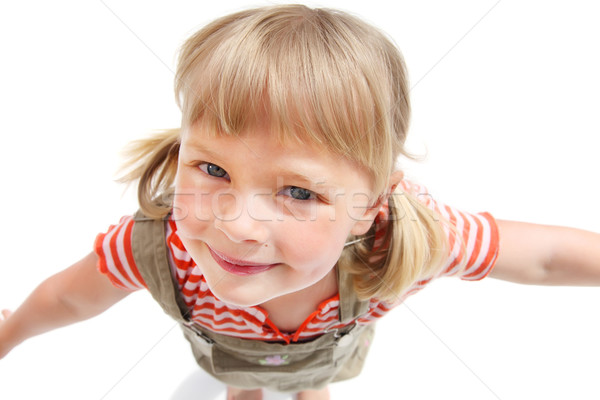 Cute little girl looking up Stock photo © hannamonika
