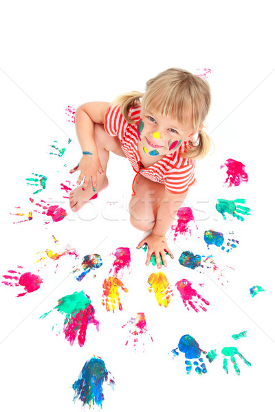 Cute little girl making colorful hand prints Stock photo © hannamonika