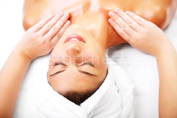 Belle femme souriante massage mains visage Photo stock © hannamonika