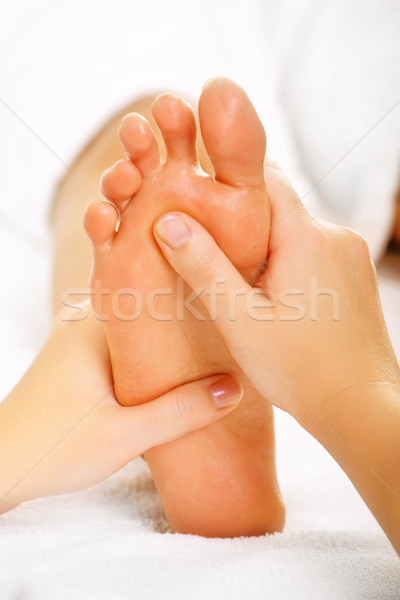 Exotic foot massage Stock photo © hannamonika