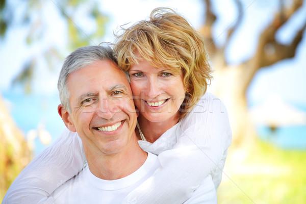 Stockfoto: Volwassen · paar · glimlachend · focus · vrouw