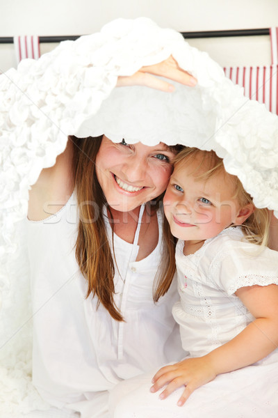 Mother and daughter playing peek-a-boo in bed Stock photo © hannamonika