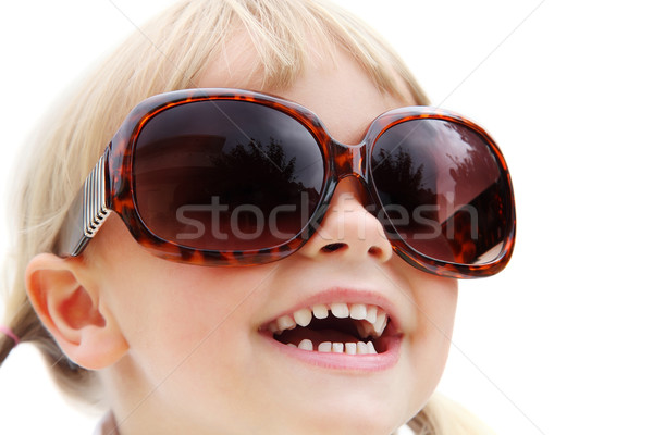 Cute little girl wearing sunglasses Stock photo © hannamonika