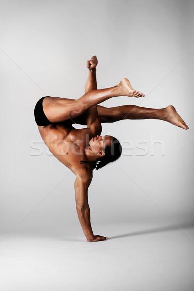 Genç erkek dansçı poz gri el Stok fotoğraf © hannamonika