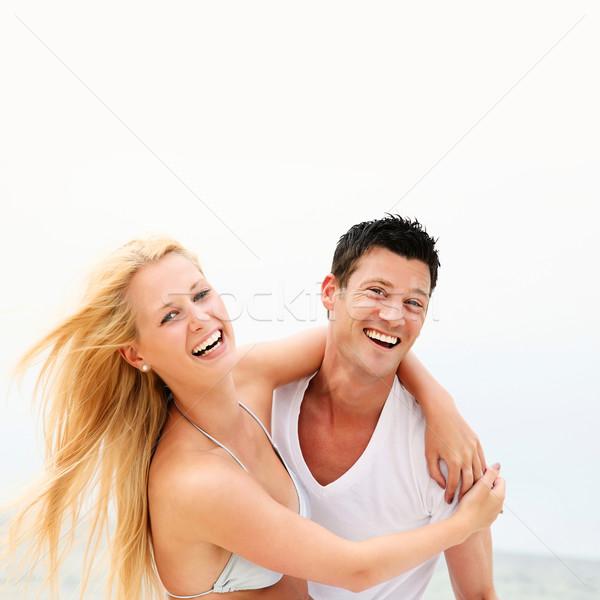 Happy couple on the beach Stock photo © hannamonika