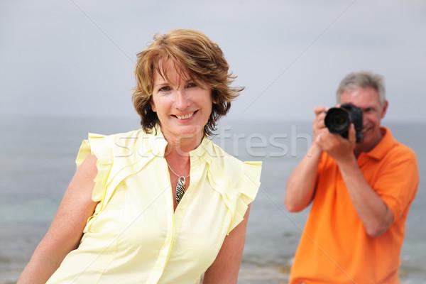 Güzel olgun kadın poz fotoğrafları kadın plaj Stok fotoğraf © hannamonika