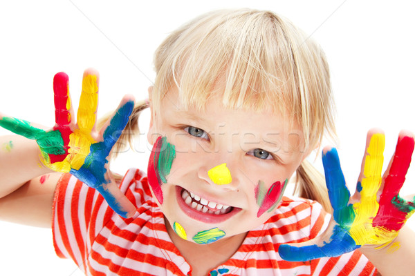 Cute little girl with painted hands Stock photo © hannamonika