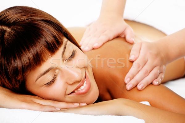 Mooie glimlachende vrouw massage handen gezicht Stockfoto © hannamonika