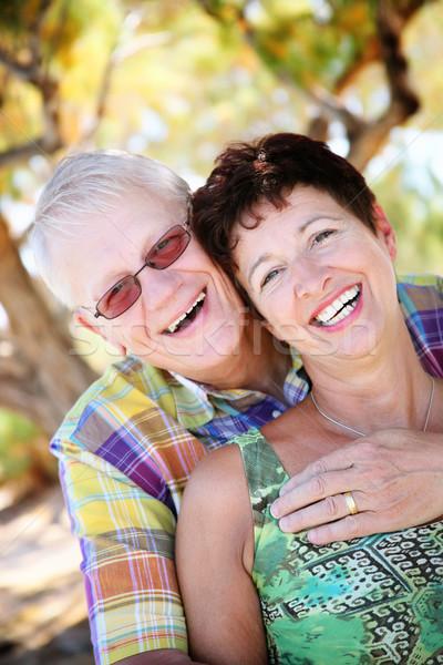 Mature couple smiling and embracing Stock photo © hannamonika