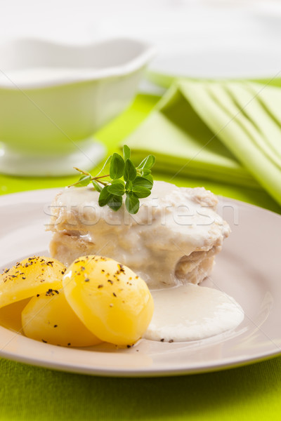 Porc crème sauce plat servi pommes de terre Photo stock © hansgeel