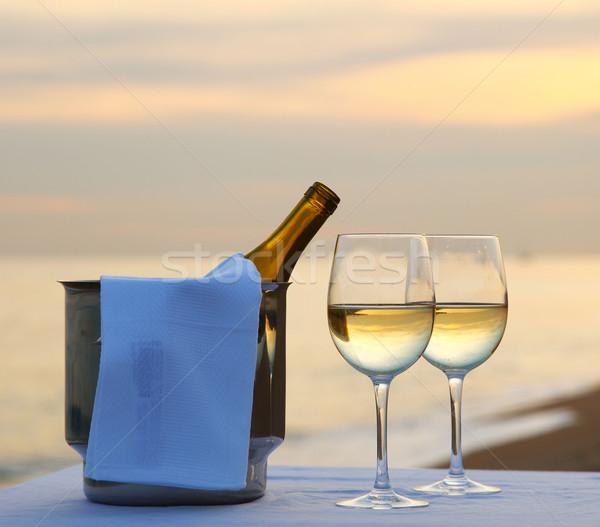 Asztal tengerpart étterem étel naplemente üveg Stock fotó © hansgeel