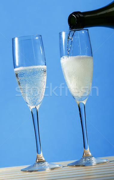 Pezsgő kettő szemüveg pezsgő bor étel Stock fotó © hansgeel