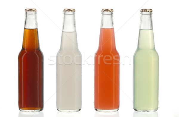 Four assorted soda bottles, alcoholic drinks with water drops Stock photo © hanusst