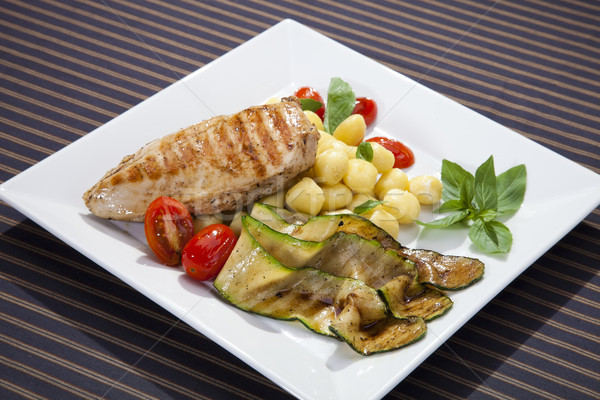 Grilled chicken breast w grilled aubergine and gnocchi Stock photo © hanusst
