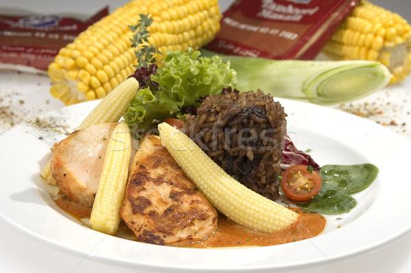 Cerdo solomillo maíz lechuga espinacas salsa de tomate Foto stock © hanusst