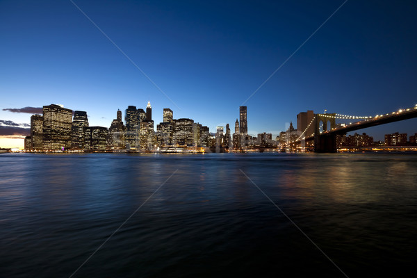 The New York City skyline at w Brooklyn Bridge Stock photo © hanusst