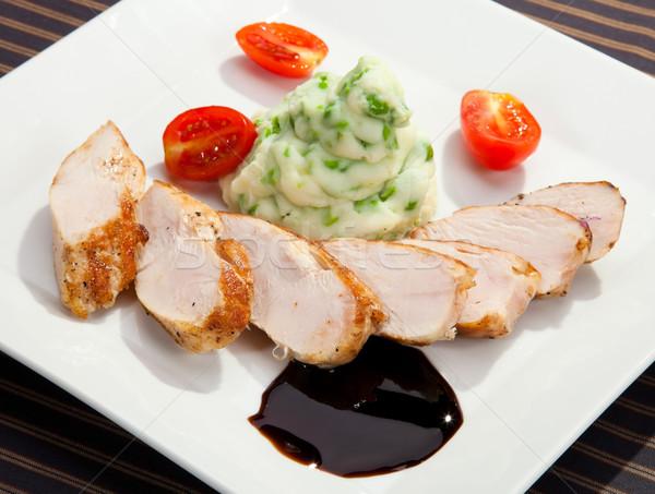 Pork tenderloin w potato puree with young peas Stock photo © hanusst