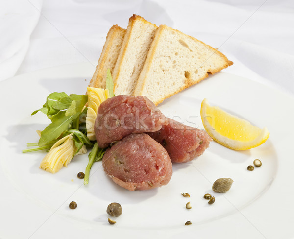 Veal steak tartar with caper and artichoke Stock photo © hanusst