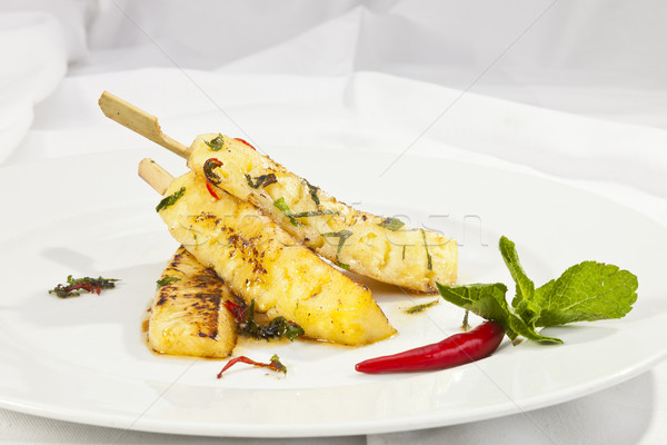 Grilled pineapple with honey Stock photo © hanusst