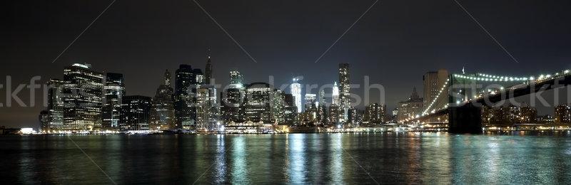 Stock photo: The New York City skyline w Brooklyn Bridge and Freedom tower