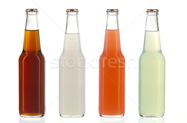 Four assorted soda bottles, alcoholic drinks Stock photo © hanusst