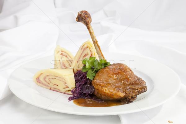 Baked duck leg with potato ham rolls Stock photo © hanusst