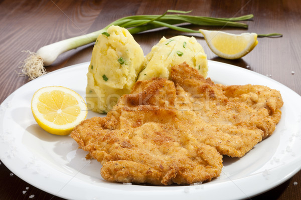 Vienna schnitzel with potato puree Stock photo © hanusst