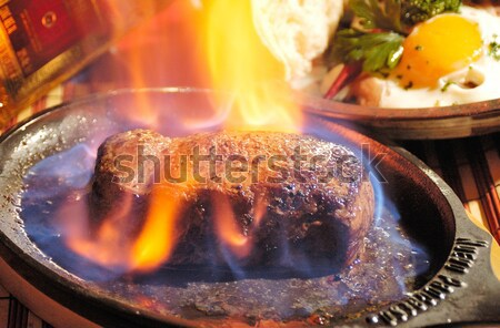 Steak flambe Stock photo © hanusst