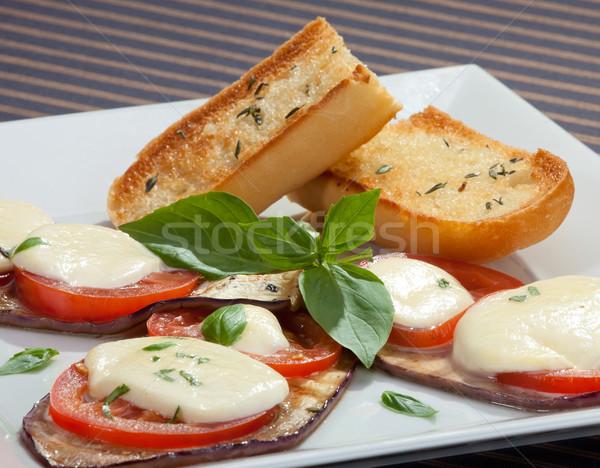 Baked aubergine w tomatoes and mozzarella Stock photo © hanusst
