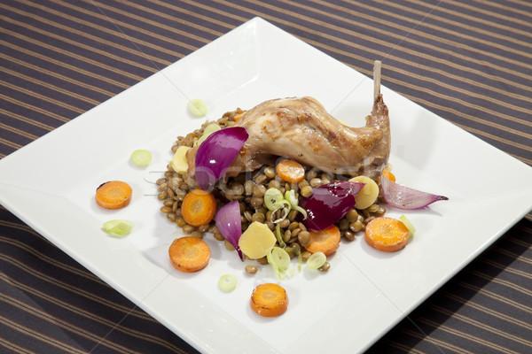 Baked rabbit leg with lentil and vegetable garnish Stock photo © hanusst