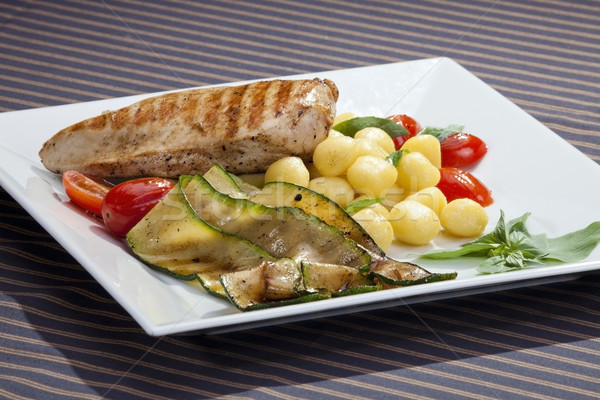 Grilled chicken breast w grilled aubergine and gnochi Stock photo © hanusst
