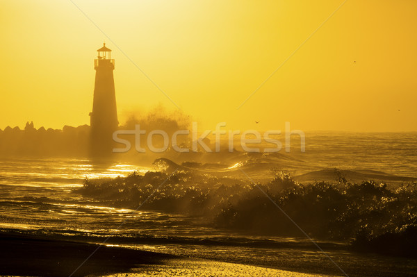 Phare rive matin nuages coucher du soleil Photo stock © hanusst