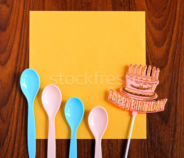 happy birthday and spoons with yellow paper on wooden background Stock photo © happydancing
