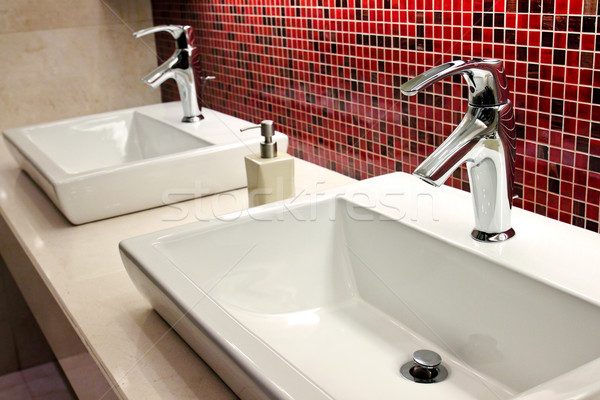 sinks and taps in a public toilet  Stock photo © happydancing