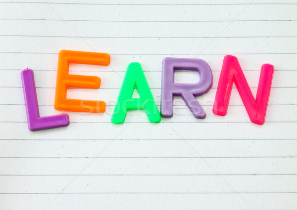 Learn in colorful toy letters on lined paper background  Stock photo © happydancing