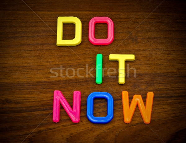 Do it now in colorful toy letters on wood background Stock photo © happydancing