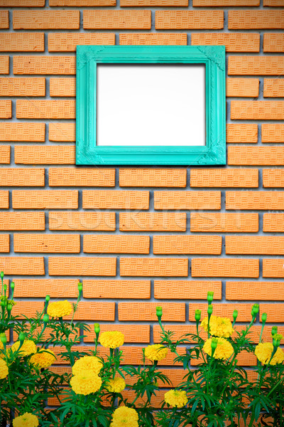 Vintage picture frame on brick wall with yellow flower Stock photo © happydancing