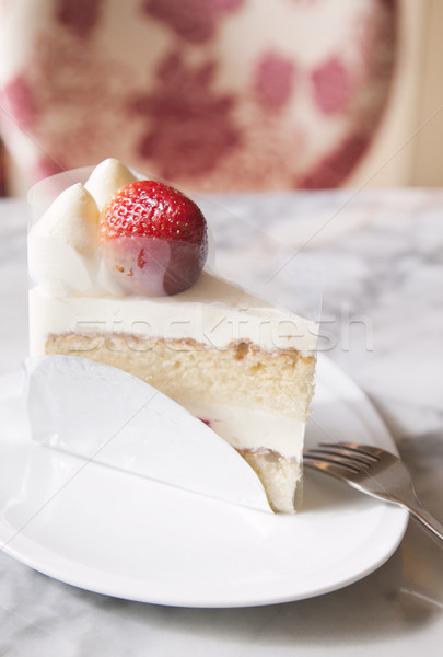 Piece of strawberry cake on white plate with fork Stock photo © happydancing