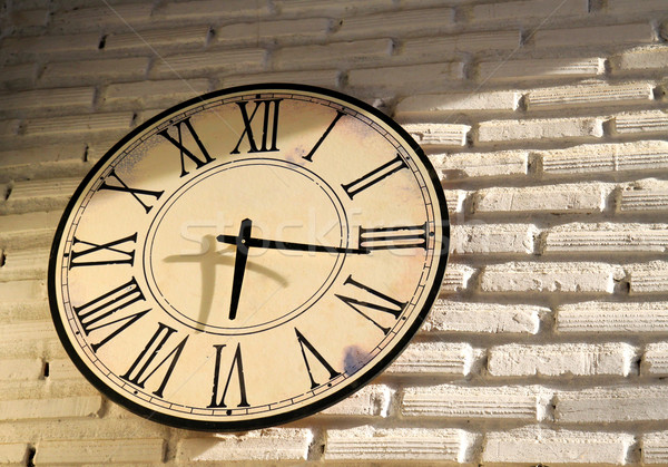 vintage wall clock on brickwall Stock photo © happydancing