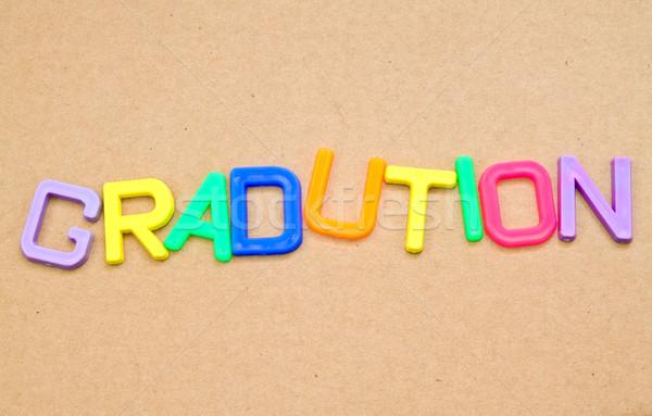 Afstuderen kleurrijk speelgoed brieven papier achtergrond Stockfoto © happydancing