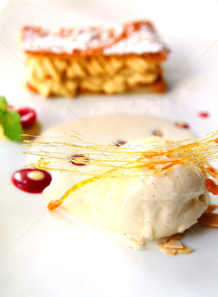 Melting vanilla ice cream with baked biscuit   Stock photo © happydancing