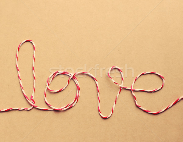 The word 'love' written with rope, retro filter effect Stock photo © happydancing