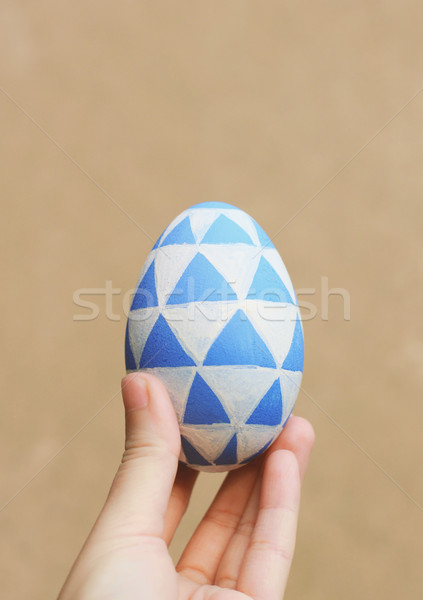 Hand holding color painted easter egg with retro filter tone Stock photo © happydancing