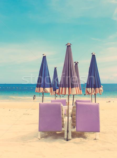 Paraguas tropicales arena playa retro Foto stock © happydancing